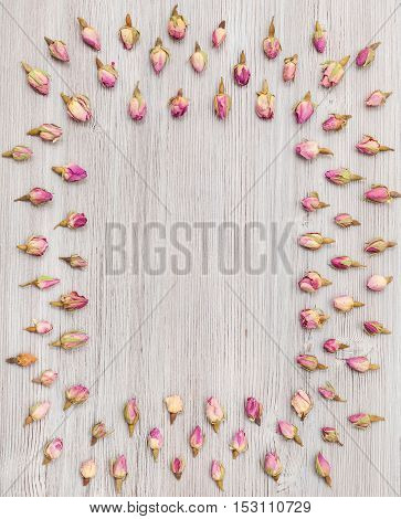 Frame From Rose Flower Buds On Wooden Board