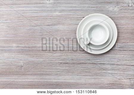 Top View Of Cup With Saucers On Gray Brown Board