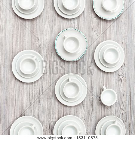 Top View Of Several Cups And Saucers On Gray Table
