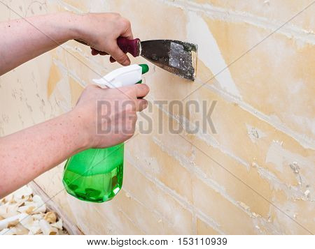 Cleaning Wall From Wet Old Wallpaper With Spatula