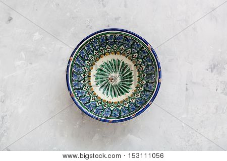 Traditional Central Asian Bowl On Concrete Plate