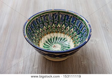 Traditional Central Asian Bowl On Gray Brown Board