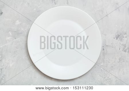 Above View Of White Plate On Gray Concrete Surface
