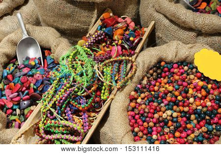 Jute Bags Filled With Trinkets And Decorations Buttons And Neckl