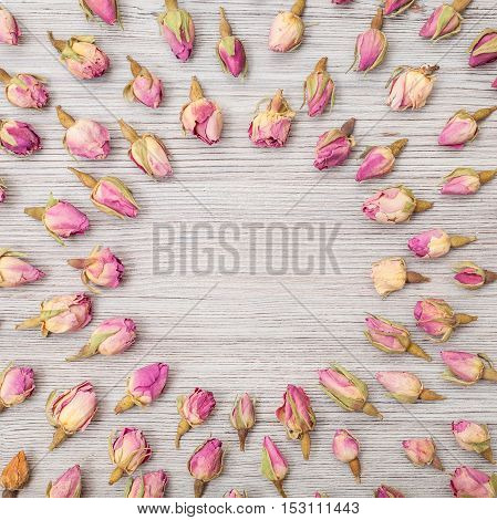 Round Frame From Rose Flower Buds On Wooden Board