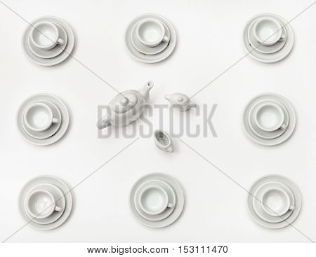 Above View Cups With Saucers And Teapot On White