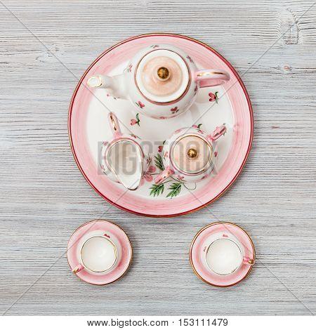 Pink Porcelain Tea Set On Gray Brown Plank
