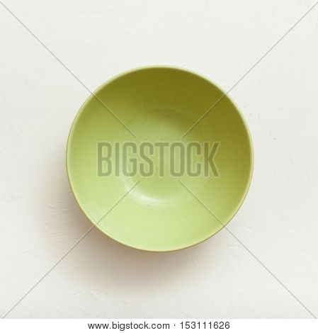 Above View Of Green Bowl On Plastering Plate