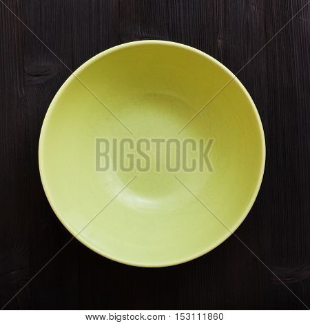Above View Of Green Bowl On Dark Brown Table