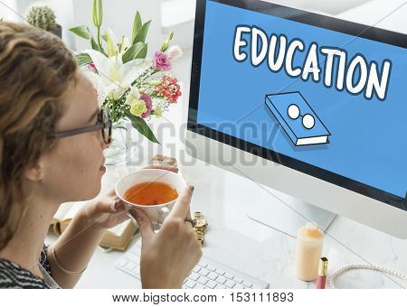 Woman researching education on computer