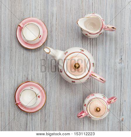 Pink Porcelain Tea Set On Gray Brown Board