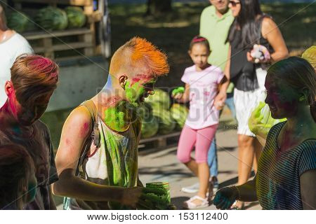 Lviv Ukraine - August 28 2016: Young people having fun during the festival of color in a city park in Lviv.