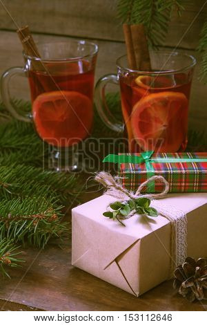 Christmas Gifts And Two Glasses Of Hot Mulled Wine