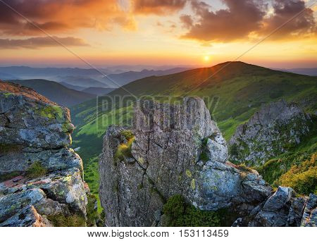 Grass and stone on the mountain hill during sundown. Beautiful summer landscape