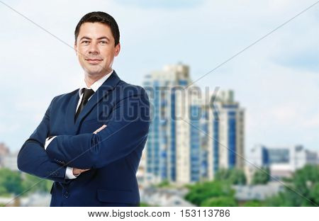 Businessman on blurred cityscape background