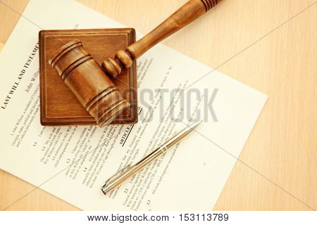 Court gavel and documents on table, top view