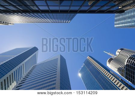 Modern skyscrapers concept against the blue sky