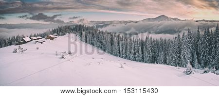 Fantastic winter landscape with dramatic sky and snowy trees. Carpathians, Ukraine, Europe. Toned like Instagram filter
