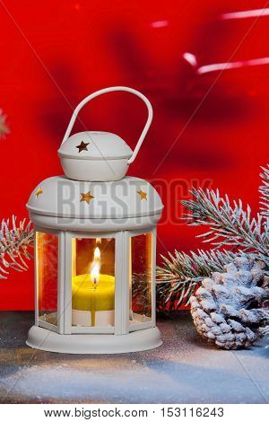 Still life with lantern and Christma tree in the snow