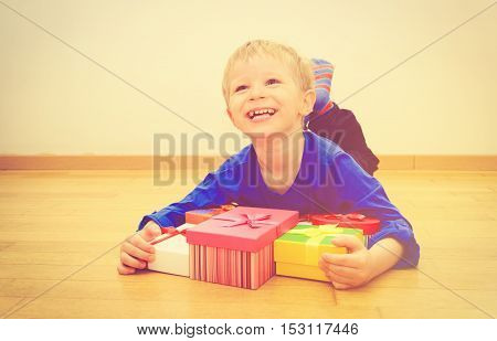 Happy little boy taking presents at family holiday, celebration concept