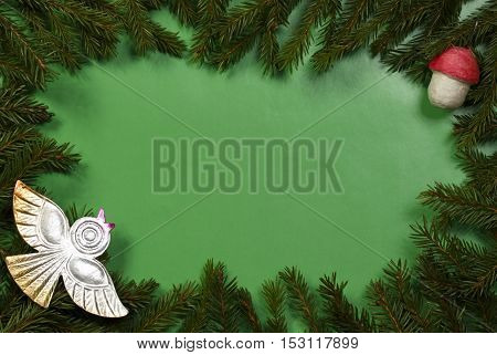 Green Christmas background from fir branches and retro New-Year tree decorations.