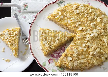 almond cake with butter cream on white plate