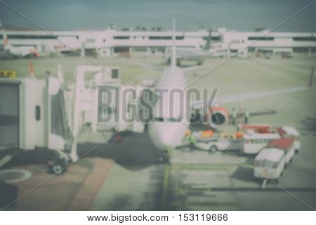 Blur background aircraft and loading unloading area airport
