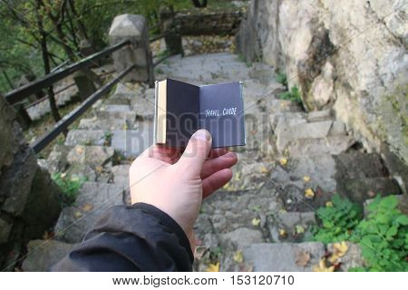 Travel guide book and beautiful old stone stairs