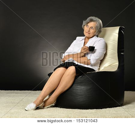 Portrait of attractive middle-aged woman with coffee