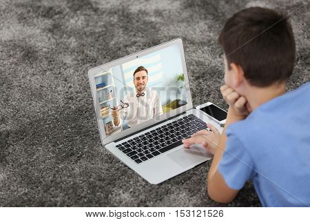 Video call and chat concept. Modern communication technology. Boy video conferencing on laptop.
