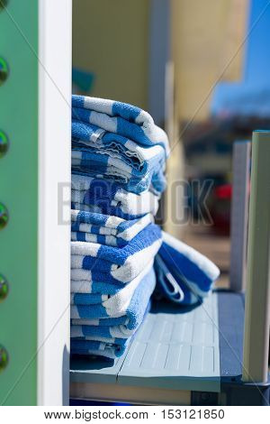 Stack of blue and white beach towels at a coastal resort