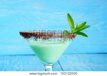 closeup chocolate mint grasshopper cocktail with blue background