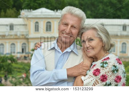 Nice senior couple walking in a park