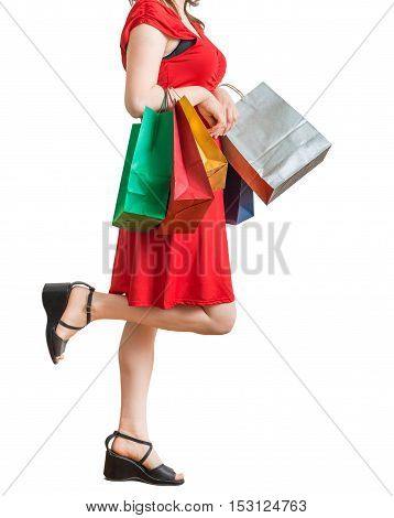 Young Pretty Woman Is Walking And Shopping With Colorful Bags. I
