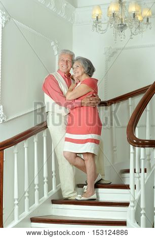 Portrait of beautiful elderly couple on the stairs