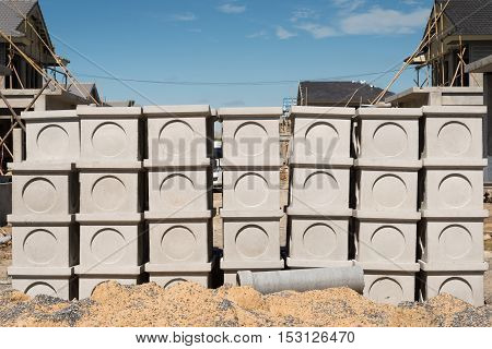 Concrete manholes waiting for use in construction job.