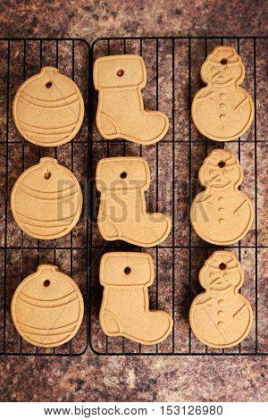 top view christmas shaped cookies on rack