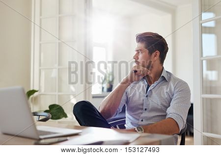 Thoughtful Businessman Sitting Home Office
