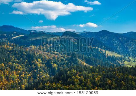 Autumn in the Carpathian hills and sky