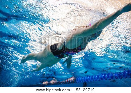 Professional Female Athlete Swimming In Pool