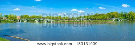 MOSCOW RUSSIA - MAY 10 2015: The Catherine's Island connected to the mainland of Tsaritsyno Park by two scenic arched bridges on May 10 in Moscow.