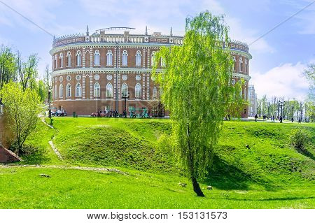 MOSCOW RUSSIA - MAY 10 2015: The scenic birch tree in ravine in Tsaritsyno Imperial Residence with the Bread House on the background on May 10 in Moscow.