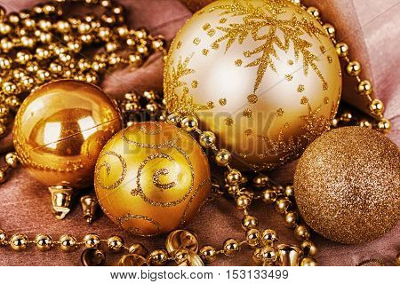 Festive Gold Christmas Decorations On Fabric Background Hdr Filter.
