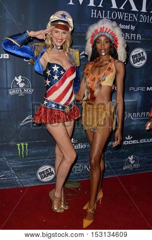 LOS ANGELES - OCT 22:  Holly Ridings, Kacey Leggett at the 2016 Maxim Halloween Party at Shrine Auditorium on October 22, 2016 in Los Angeles, CA
