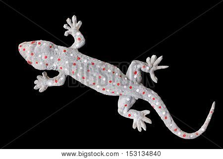 Gecko doll isolated on black background with clipping part.