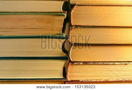 Stack of old vintage books background. Education