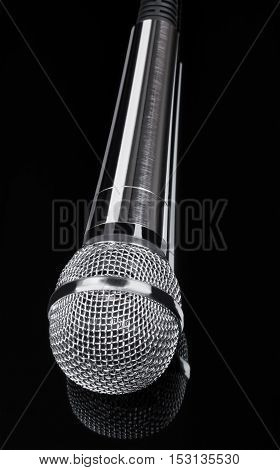 Shiny microphone on a dark gray background