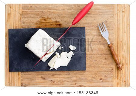 Red Knife Cutting Feta Cheese