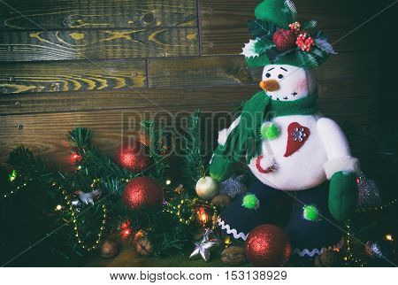 Christmas Snowman On A Wooden Background, New Year.s Toys
