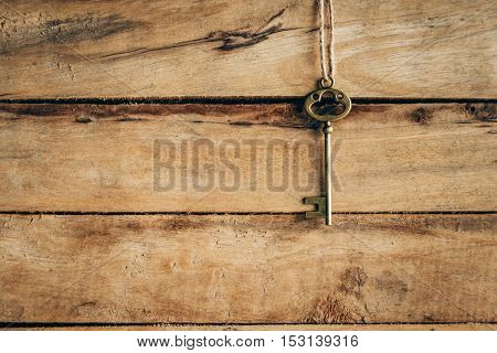 Old Key Vintage Hanging On Wooden Background With Space